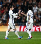 MADRID, SPAIN - FEBRUARY 15: Marcelo and James Rodriguez )L) of Real Madrid celebrate after scoring during the UEFA Champions League Round of 16 first leg match between Real Madrid CF and SSC Napoli at Estadio Santiago Bernabeu on February 15, 2017 in Madrid, Spain. (Photo by Helios de la Rubia/Real Madrid via Getty Images)