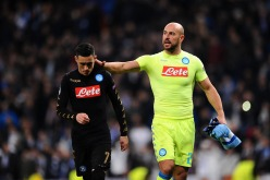MADRID, SPAIN - FEBRUARY 15: Jose Callejon of SSC Napoli is consoled by teammate Pepe Reina after his tream lost 3-1 to Real Madrid CF during the UEFA Champions League Round of 16 first leg match between Real Madrid CF and SSC Napoli at Estadio Santiago Bernabeu on February 15, 2017 in Madrid, Spain. (Photo by Denis Doyle - UEFA/UEFA via Getty Images)